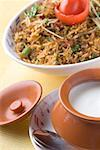Close-up of a bowl of fried rice with a bowl of curd on a plate Stock Photo - Premium Royalty-Freenull, Code: 630-01491449