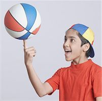 preteen  smile  one  alone - Close-up of a boy spinning a basketball on his finger Stock Photo - Premium Royalty-Freenull, Code: 630-01491546