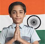 Close-up of a boy in a prayer position in front of the Indian flag Stock Photo - Premium Royalty-Free, Artist: RAW FILE, Code: 630-01491572