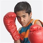 Portrait of a boy wearing boxing gloves Stock Photo - Premium Royalty-Freenull, Code: 630-01491577