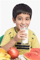 Close-up of a boy drinking a glass of milk Stock Photo - Premium Royalty-Freenull, Code: 630-01491710