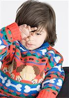 Close-up of a boy rubbing his eyes Stock Photo - Premium Royalty-Freenull, Code: 630-01491917