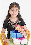 Portrait of a girl in traditional clothing holding gifts Stock Photo - Premium Royalty-Free, Artist: Photosindia, Code: 630-01492093