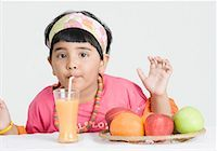 Portrait of a girl drinking juice with a drinking straw Stock Photo - Premium Royalty-Freenull, Code: 630-01492188