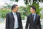 Two businessmen looking at each other and smiling Stock Photo - Premium Royalty-Freenull, Code: 630-01492667