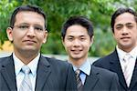 Portrait of three businessmen in a row Stock Photo - Premium Royalty-Freenull, Code: 630-01492714