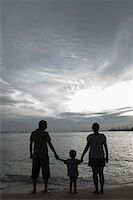 Silhouette of a couple with their son on the beach Stock Photo - Premium Royalty-Freenull, Code: 630-01493060