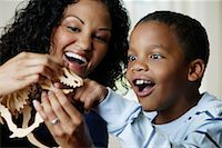 pre-teen boy models - Mother and Son Playing with Dinosaur Model    Stock Photo - Premium Rights-Managednull, Code: 700-01519694