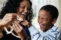 Mother and Son Playing with Dinosaur Toy    Stock Photo - Premium Rights-Managednull, Code: 700-01519695
