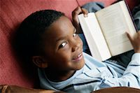 preteen  smile  one  alone - Little Boy Reading    Stock Photo - Premium Rights-Managednull, Code: 700-01519702
