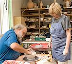 Mature woman watching senior man make bowl on pottery wheel Stock Photo - Premium Royalty-Free, Artist: Masterfile, Code: 613-01529779