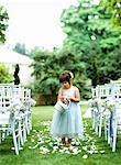 Flower girl (3-5) scattering flower petals down aisle Stock Photo - Premium Royalty-Free, Artist: Karen Whylie, Code: 613-01532601