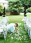 Flower girl (3-5) scattering flower petals down aisle, rear view Stock Photo - Premium Royalty-Free, Artist: Ikonica, Code: 613-01532602