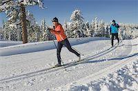 USA, California, teenage girl (16 18) and man cross-country skiing Stock Photo - Premium Royalty-Freenull, Code: 613-01533378