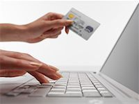 Woman using laptop computer, holding credit card, close-up Stock Photo - Premium Royalty-Freenull, Code: 613-01535606