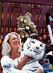 Woman at Amusement Park, Holding Stuffed Animal    Stock Photo - Premium Rights-Managed, Artist: Anne Domdey, Code: 700-01539048