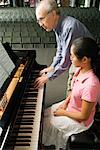 Teacher Helping Girl Prepare for Recital