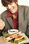 Laughing man with soup and sandwich Stock Photo - Premium Royalty-Free, Artist: Narratives, Code: 621-01554030