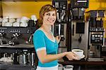 Smiling woman holding cup of coffee Stock Photo - Premium Royalty-Free, Artist: Edward Pond, Code: 621-01554172