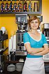Woman standing beside espresso machine Stock Photo - Premium Royalty-Free, Artist: Emanuele Ciccomartino, Code: 621-01554175