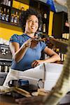Smiling woman serving customer Stock Photo - Premium Royalty-Free, Artist: Ron Fehling, Code: 621-01554185