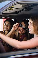 Group of friends in SUV Stock Photo - Premium Royalty-Freenull, Code: 621-01554365