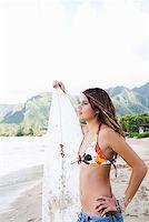 Pensive teenage girl holding surfboard Stock Photo - Premium Royalty-Freenull, Code: 621-01554378