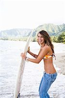 Laughing teenage girl holding surfboard Stock Photo - Premium Royalty-Freenull, Code: 621-01554379