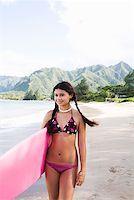 Teenage girl carrying surfboard Stock Photo - Premium Royalty-Freenull, Code: 621-01554382