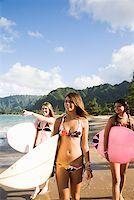 Teenage girls carrying surfboards Stock Photo - Premium Royalty-Freenull, Code: 621-01554386