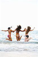 Three friends jumping on beach Stock Photo - Premium Royalty-Freenull, Code: 621-01554396
