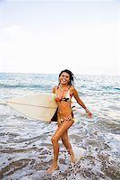 Teenage girl running through surf Stock Photo - Premium Royalty-Freenull, Code: 621-01554400