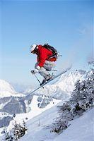 Austria, Saalbach, male skier jumping past trees on slope Stock Photo - Premium Royalty-Freenull, Code: 649-01555995