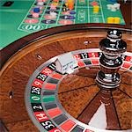 Miniature house on roulette wheel Stock Photo - Premium Royalty-Free, Artist: Cultura RM, Code: 604-01570759