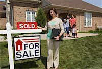 sold sign - Real Estate Agent by Sold Sign    Stock Photo - Premium Rights-Managednull, Code: 700-01571980