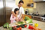 Father and Daughter Preparing Dinner    Stock Photo - Premium Rights-Managed, Artist: Mark Leibowitz, Code: 700-01572079