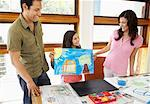 Daughter Showing Parents Artwork    Stock Photo - Premium Rights-Managed, Artist: Mark Leibowitz, Code: 700-01572089