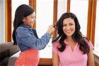 Daughter Brushing Mother's Hair    Stock Photo - Premium Rights-Managednull, Code: 700-01572100
