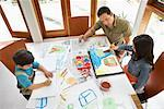 Father Watching Children Paint    Stock Photo - Premium Rights-Managed, Artist: Mark Leibowitz, Code: 700-01572117