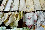 Cyprus, Paphos, embroidered tablecloths for sale at the market