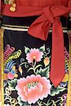 China, Yunnan, near Kunming, Yunnan Nationalities Village, close-up of traditional costume