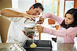 Father and Daughter Baking    Stock Photo - Premium Rights-Managed, Artist: Mark Leibowitz, Code: 700-01579463