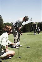 Couples Playing Golf    Stock Photo - Premium Royalty-Freenull, Code: 600-01581857