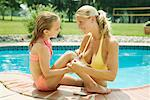 Mother and Daughter by Swimming Pool    Stock Photo - Premium Rights-Managed, Artist: Michael A. Keller, Code: 700-01581896