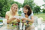 Women Sitting at Table Outdoors having Lunch    Stock Photo - Premium Rights-Managed, Artist: Michael A. Keller, Code: 700-01581916