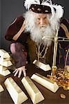 King Weighing Gold Bars