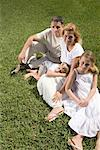 Portrait of family on lawn Stock Photo - Premium Royalty-Freenull, Code: 638-01583402