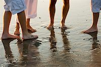female 16 year old feet - Close-up of bare feet of a family of four standing on wet sand on beach Stock Photo - Premium Royalty-Freenull, Code: 638-01584075
