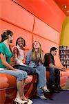 Portrait of teenage boys and girls hanging out in the library Stock Photo - Premium Royalty-Free, Artist: Brian Pieters, Code: 638-01584661
