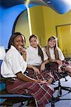 Portrait of three teenage girl students wearing uniforms in a classroom Stock Photo - Premium Royalty-Free, Artist: Brian Pieters, Code: 638-01584688